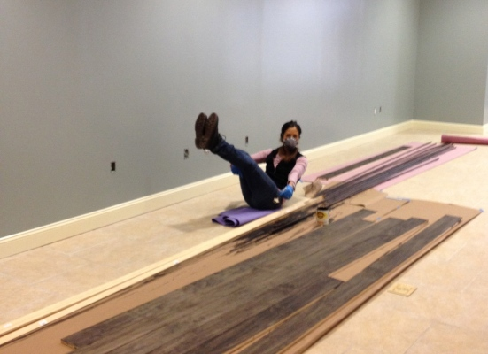 Carla installs the wood flooring while doing a teaser the entire time.....we knew she was amazing, but this takes it to a whole new level!